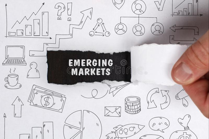 Business, Technology, Internet and network concept. Young businessman shows the word: Emerging markets stock photography