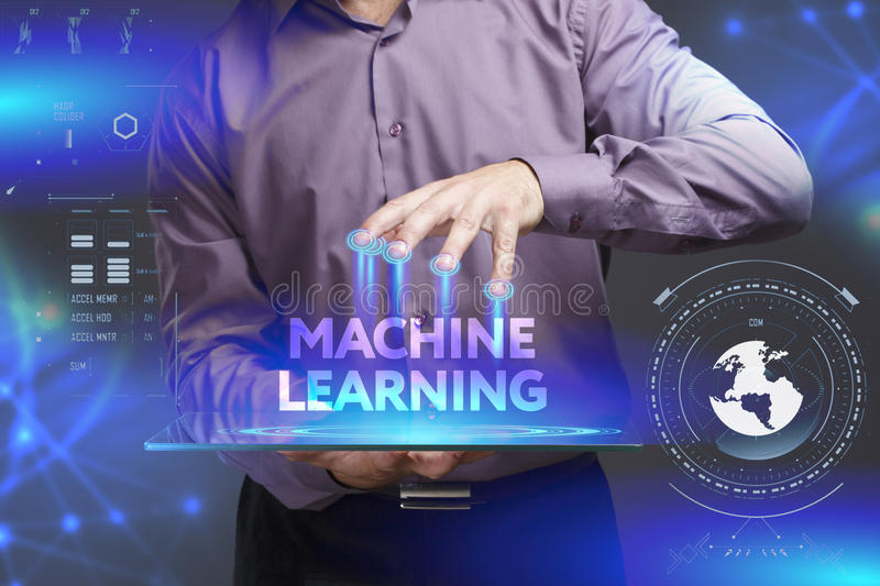 Business, Technology, Internet and network concept. Young businessman shows the word on the virtual display. Of the future: Machine learning royalty free stock image
