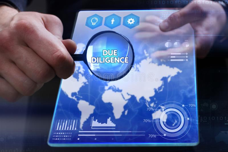 Business, Technology, Internet and network concept. Young businessman showing a word in a virtual tablet of the future: Due. Diligence stock images