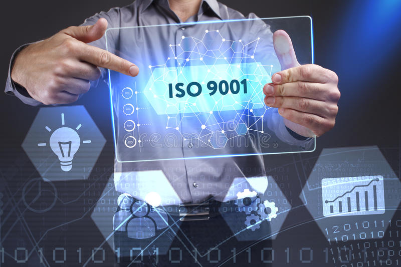 Business, Technology, Internet and network concept. Young businessman showing a word in a virtual tablet of the future: ISO 9001 stock image