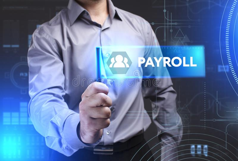 Business, Technology, Internet and network concept. Young businessman showing a word in a virtual tablet of the future: Payroll royalty free stock photography