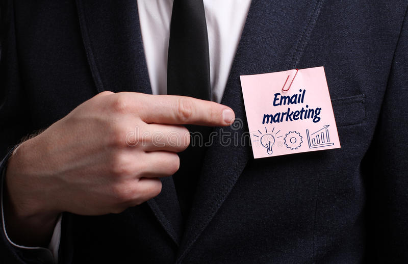 Business, Technology, Internet and network concept. Young businessman shows the word: Email marketing royalty free stock photos
