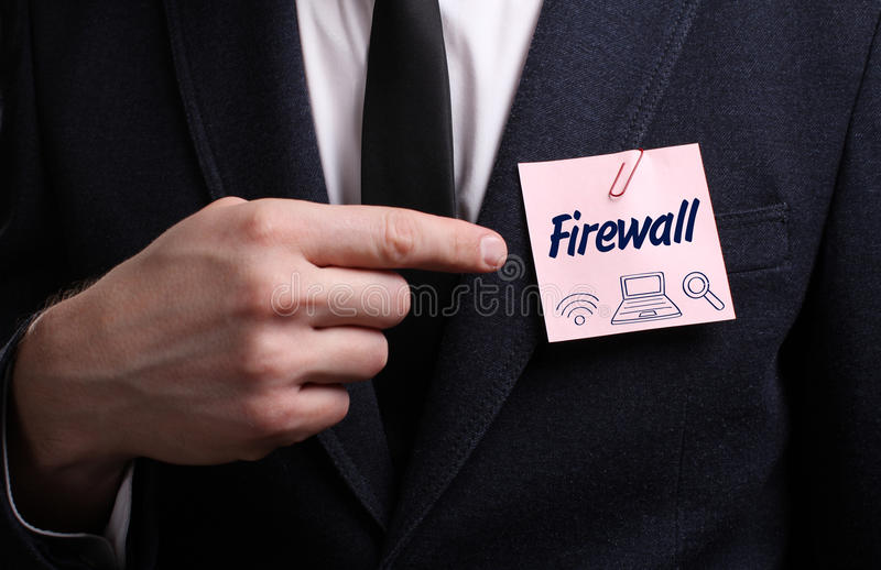 Business, Technology, Internet and network concept. Young businessman shows the word: Firewall royalty free stock photos