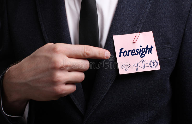Business, Technology, Internet and network concept. Young businessman shows the word: Foresight stock photos