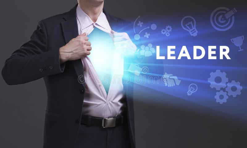 Business, Technology, Internet and network concept. Young businessman shows the word: Leader royalty free stock photo