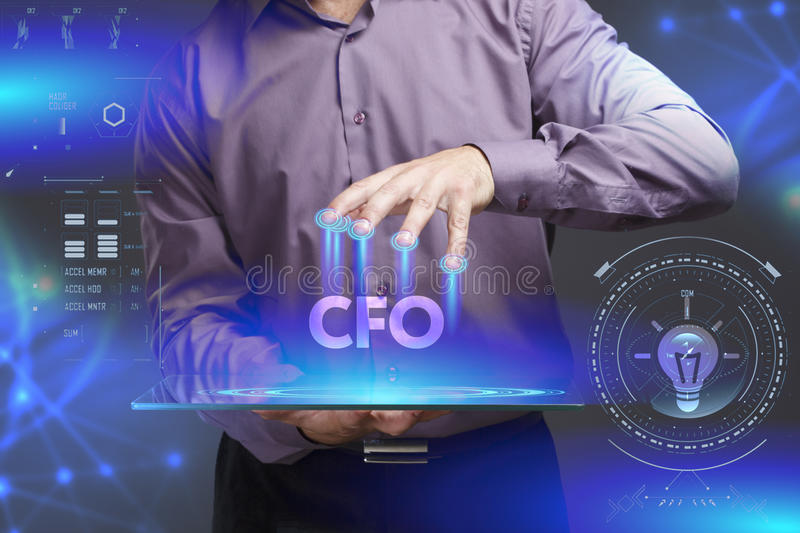 Business, Technology, Internet and network concept. Young businessman shows the word on the virtual display of the future: CFO stock photography