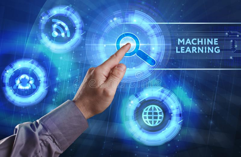 Business, Technology, Internet and network concept. Young businessman working on a virtual screen of the future and sees. The inscription: Machine learning royalty free stock photography