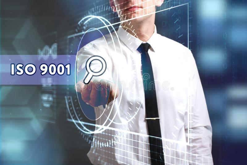 Business, Technology, Internet and network concept. Young businessman working on a virtual screen of the future and sees. The inscription: ISO 9001 royalty free stock images