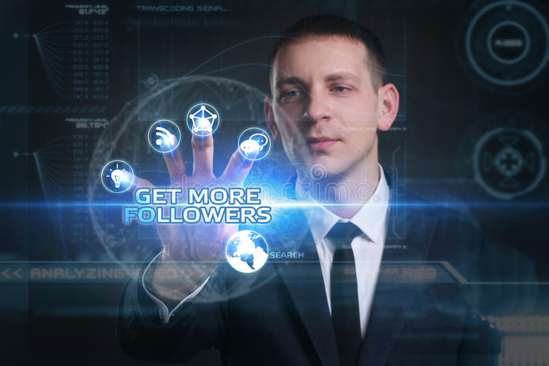 Business, Technology, Internet and network concept. Young businessman working on a virtual screen of the future and sees. The inscription: get more followers royalty free stock image