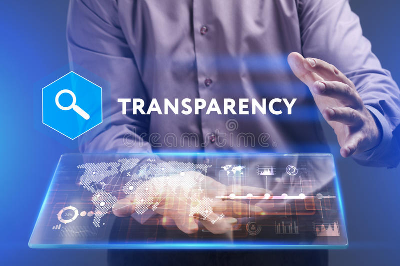 Business, Technology, Internet and network concept. Young businessman working on a virtual screen of the future and sees. The inscription: Transparency royalty free stock images