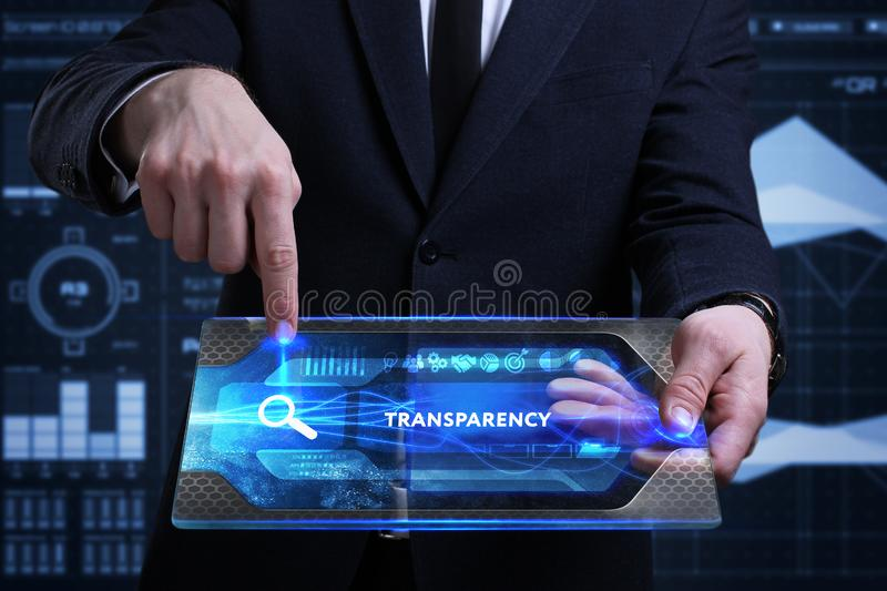 Business, Technology, Internet and network concept. Young businessman working on a virtual screen of the future and sees. The inscription: Transparency royalty free stock photo