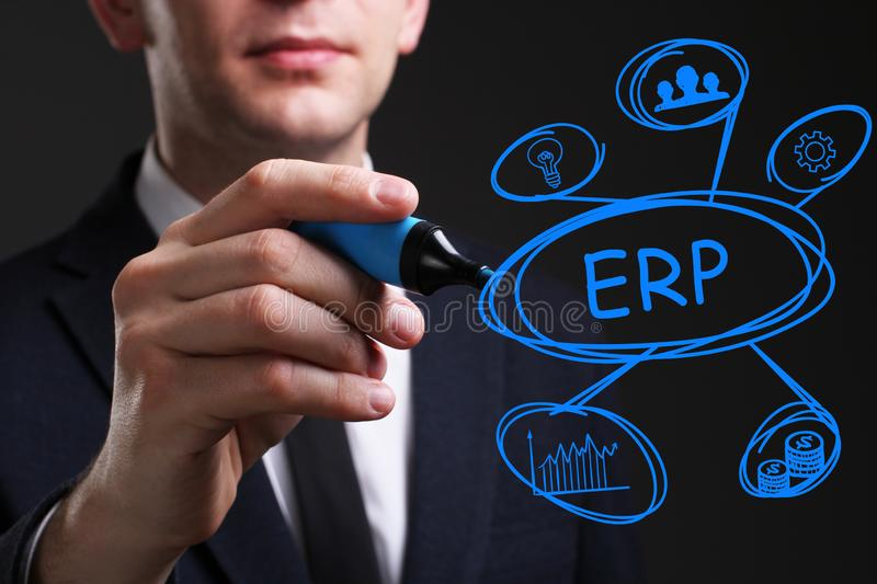 Business, Technology, Internet and network concept. Young business man writing word: ERP royalty free stock images