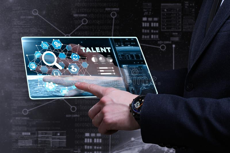 Business, Technology, Internet and network concept. Young business man writing word: talent stock photos