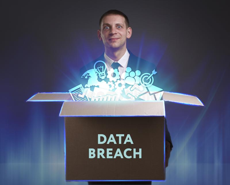 Business, Technology, Internet and network concept. Young businessman shows the word: Data breach. Business, Technology, Internet and network concept. Young stock images