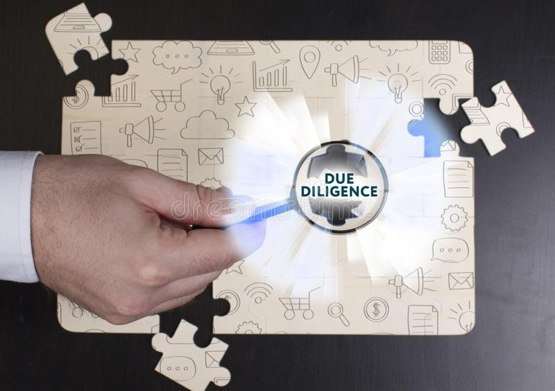 Business, Technology, Internet and network concept. Young businessman shows the word: Due diligence royalty free stock photo