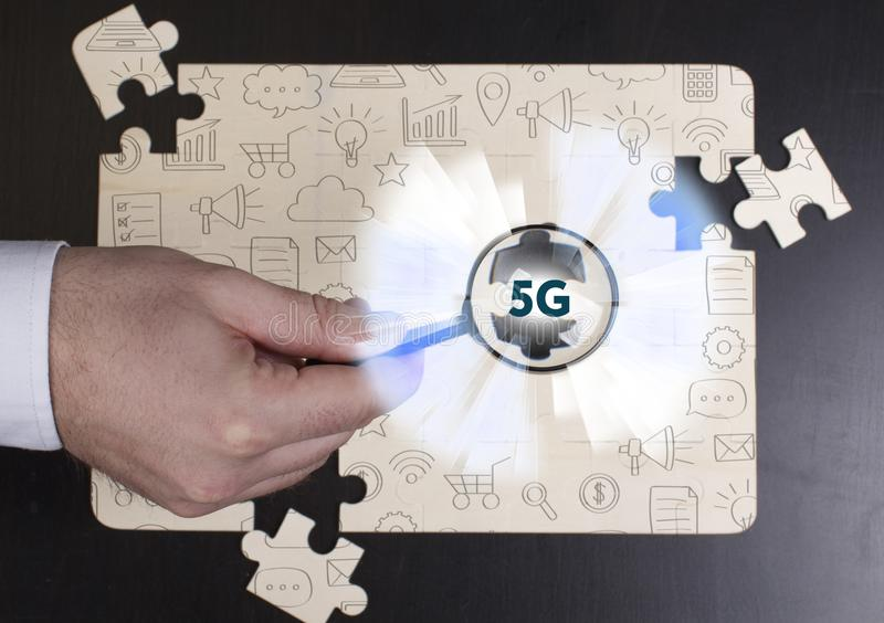 Business, Technology, Internet and network concept. Young businessman shows the word: 5G royalty free stock photos