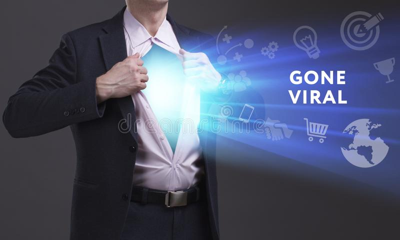 Business, Technology, Internet and network concept. Young businessman shows the word: Gone viral royalty free stock photos