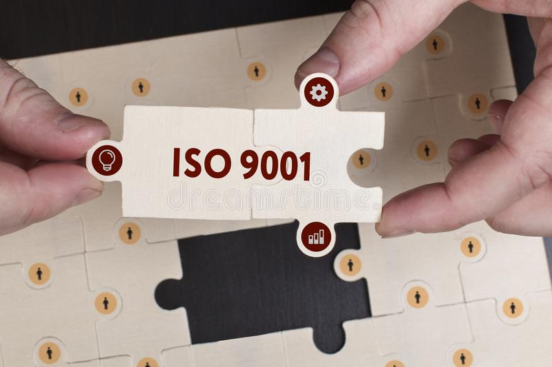 Business, Technology, Internet and network concept. Young businessman shows the word: ISO 9001 royalty free stock photography