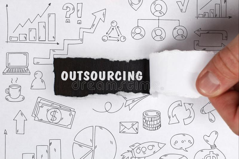 Business, Technology, Internet and network concept. Young businessman shows the word: Outsourcing stock photography