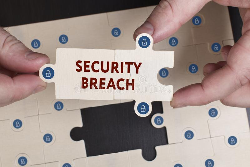 Business, Technology, Internet and network concept. Young businessman shows the word: Security breach stock photography