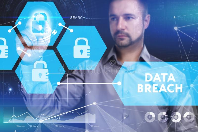 Business, Technology, Internet and network concept. Young businessman. Shows the word on the virtual display of the future: Data breach royalty free stock photo