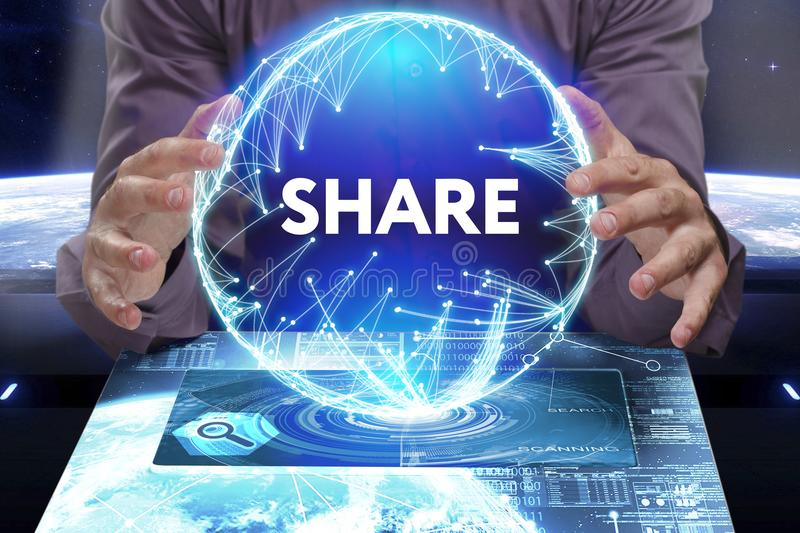 Business, Technology, Internet and network concept. Young businessman shows the word on the virtual display of the future: Share royalty free stock photo