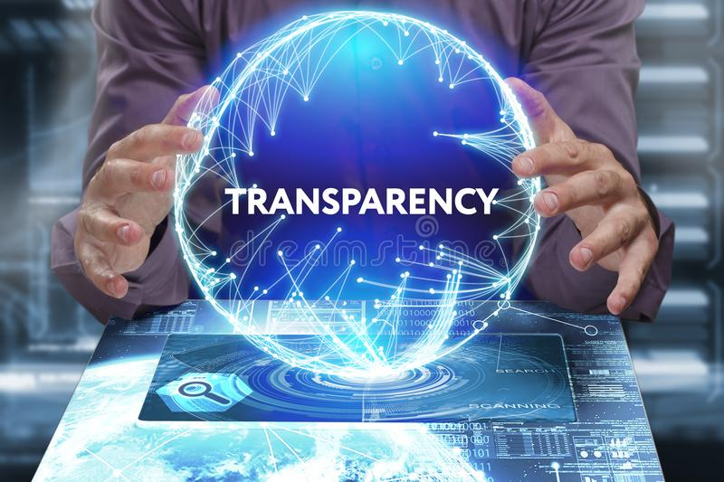 Business, Technology, Internet and network concept. Young businessman shows the word on the virtual display. Of the future: Transparency stock image