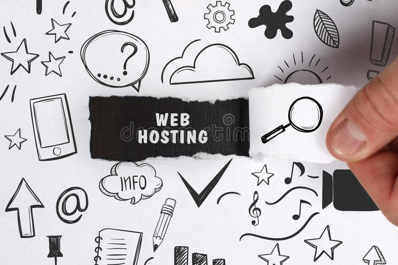 Business, Technology, Internet and network concept. Young businessman shows the word: Web hosting royalty free stock photo