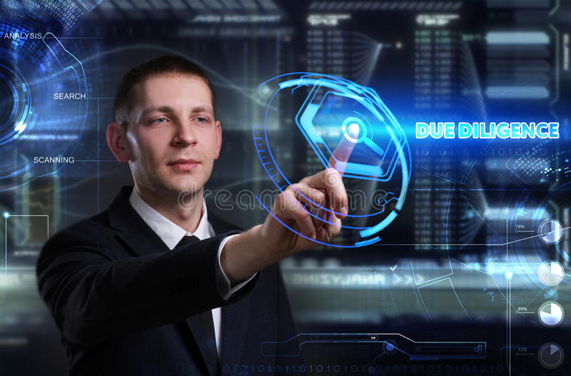 Business, Technology, Internet and network concept. Young businessman working on a virtual blackboard of the future, he sees. The inscription: due diligence royalty free stock images