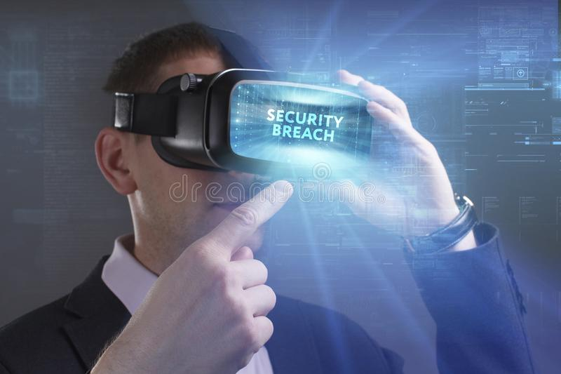 Business, Technology, Internet and network concept. Young businessman working in virtual reality glasses sees the inscription:. Security breach royalty free stock photo