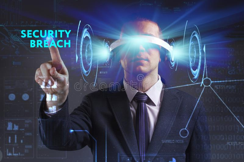 Business, Technology, Internet and network concept. Young businessman working in virtual reality glasses sees the inscription:. Security breach stock photo