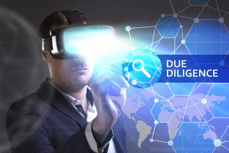 Business, Technology, Internet and network concept. Young businessman working in virtual reality glasses sees the inscription: Due. Diligence stock photos