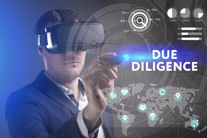 Business, Technology, Internet and network concept. Young businessman working in virtual reality glasses sees the inscription: Due. Diligence royalty free stock images