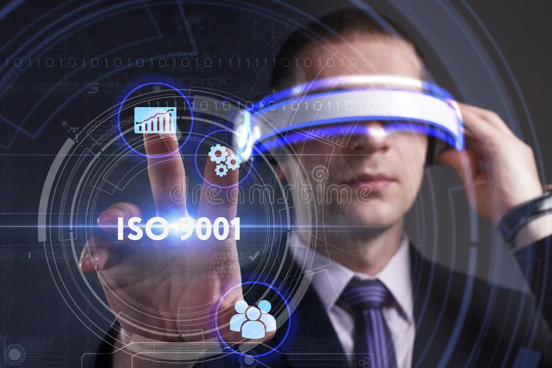 Business, Technology, Internet and network concept. Young businessman working in virtual reality glasses sees the inscription: IS. O 9001 royalty free stock images