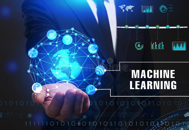 Business, Technology, Internet and network concept. Young businessman working on a virtual screen of the future and sees. The inscription: Machine learning stock photography