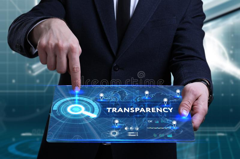 Business, Technology, Internet and network concept. Young businessman working on a virtual screen of the future and sees. The inscription: Transparency royalty free stock image