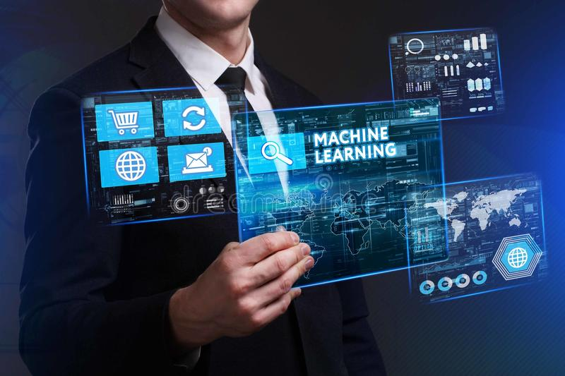 Business, Technology, Internet and network concept. Young businessman working on a virtual screen of the future and sees. The inscription: Machine learning stock images