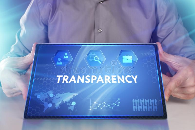 Business, Technology, Internet and network concept. Young businessman working on a virtual screen of the future and sees. The inscription: Transparency stock photography