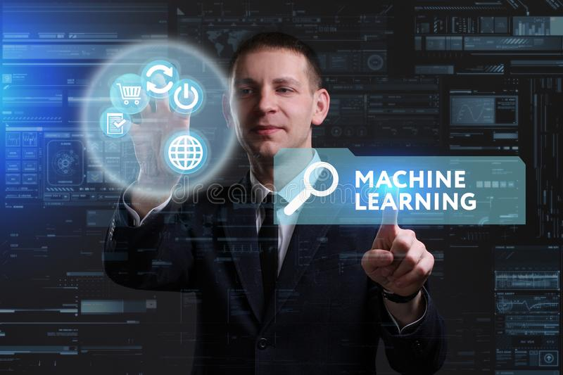 Business, Technology, Internet and network concept. Young businessman working on a virtual screen of the future and sees. The inscription: Machine learning royalty free stock photo