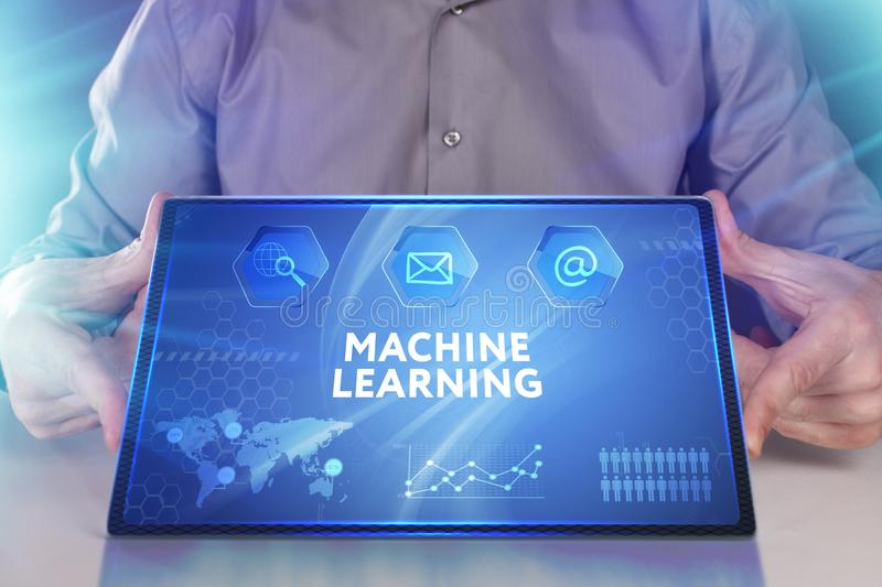 Business, Technology, Internet and network concept. Young businessman working on a virtual screen of the future and sees. The inscription: Machine learning stock photos