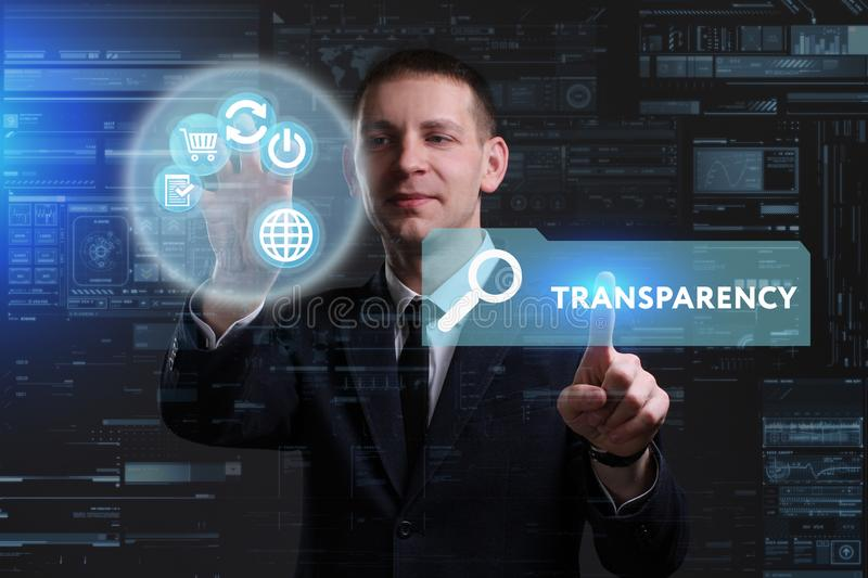 Business, Technology, Internet and network concept. Young businessman working on a virtual screen of the future and sees. The inscription: Transparency stock photos