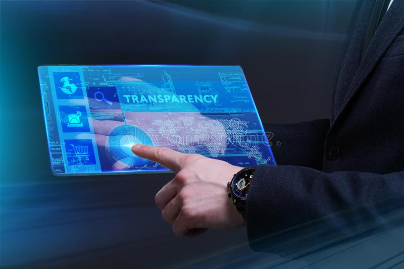 Business, Technology, Internet and network concept. Young businessman working on a virtual screen of the future and sees. The inscription: Transparency stock image