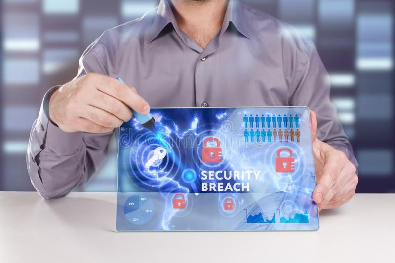 Business, Technology, Internet and network concept. Young businessman working on a virtual screen of the future and sees the. Inscription: Security breach royalty free stock image