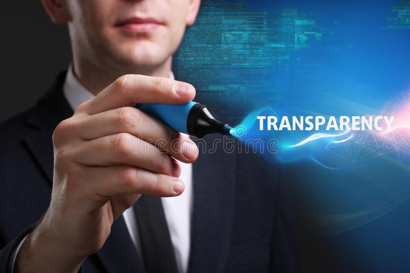 Business, Technology, Internet and network concept. Young businessman working on a virtual screen of the future and sees the. Inscription: Transparency stock photography