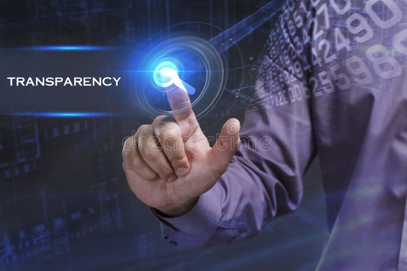 Business, Technology, Internet and network concept. Young businessman working on a virtual screen of the future and sees the. Inscription: Transparency stock images