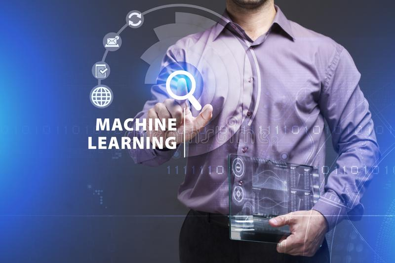 Business, Technology, Internet and network concept. Young businessman working on a virtual screen of the future and sees the. Inscription: Machine learning stock photography