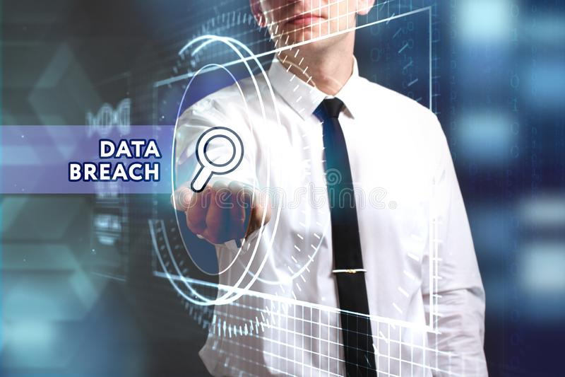 Business, Technology, Internet and network concept. Young businessman working on a virtual screen of the future and sees the. Inscription: Data breach royalty free stock photo