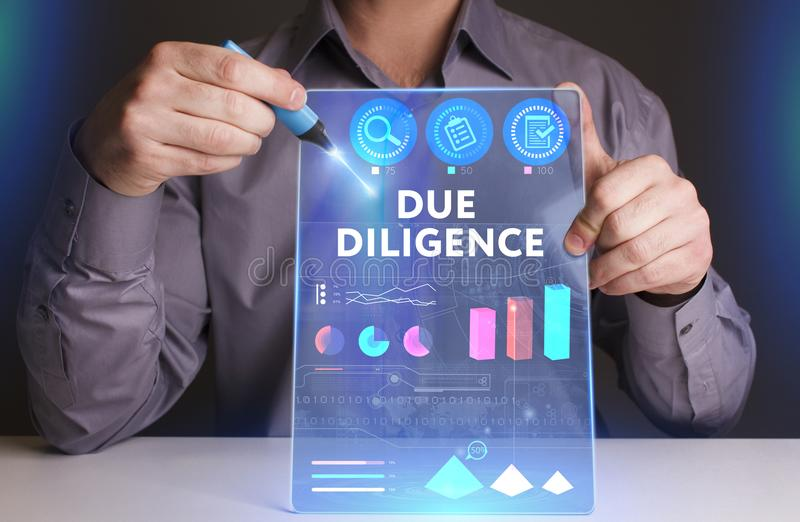 Business, Technology, Internet and network concept. Young businessman working on a virtual screen of the future and sees. The inscription: Due diligence royalty free stock photography