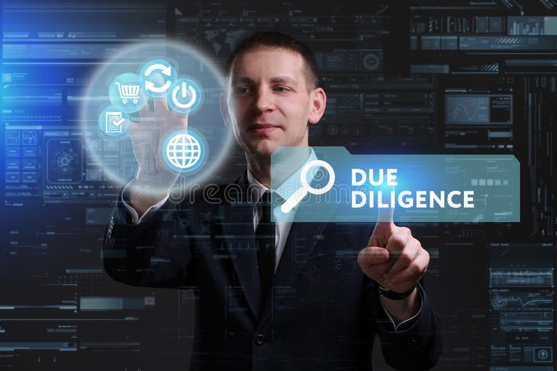 Business, Technology, Internet and network concept. Young businessman working on a virtual screen of the future and sees. The inscription: Due diligence stock photo