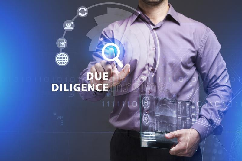Business, Technology, Internet and network concept. Young businessman working on a virtual screen of the future and sees the. Inscription: Due diligence stock photography